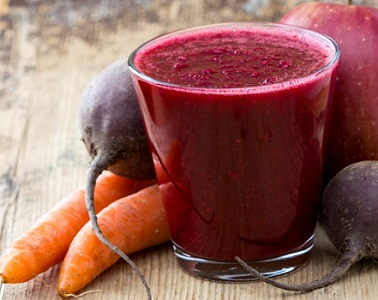 Apple, Carrot and Beet juice on wooden table